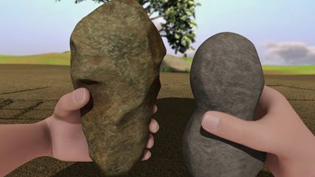 hands holding stones