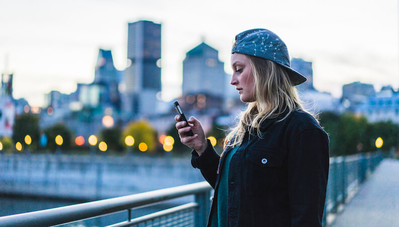 Young woman holding phone