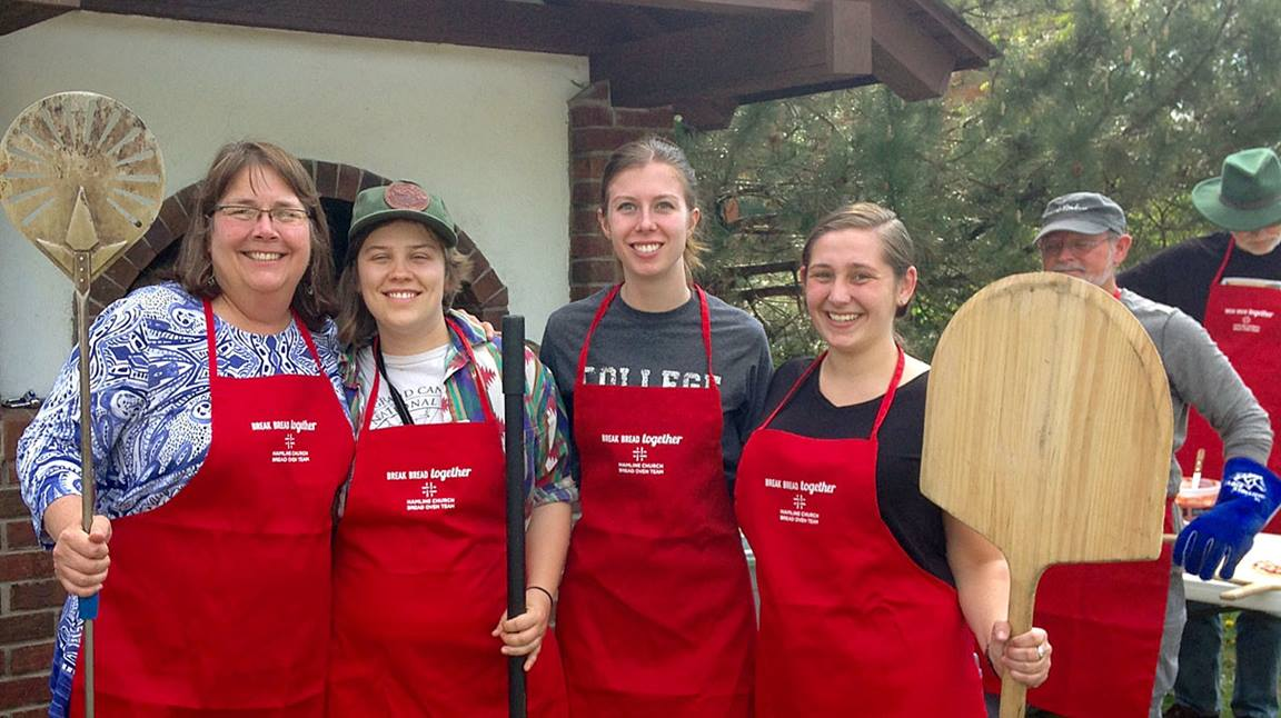 As the Hamline Community Bread Oven pizza bakers, the Rev. Nancy Victorin-Vangerud, left, and Hamline students learn skills of hospitality and baking for their neighborhood. Courtesy photo.