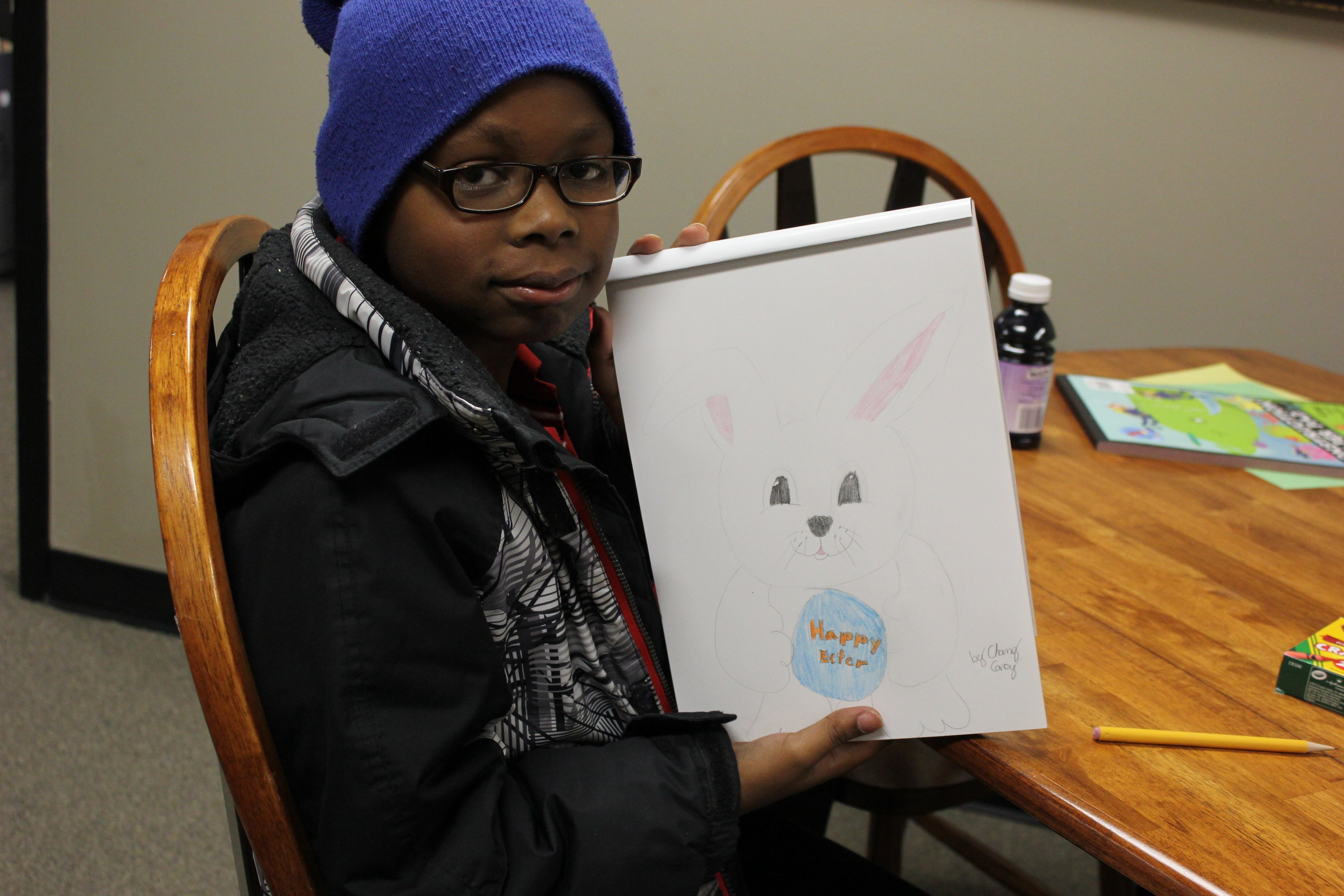 Chanz shows his drawing of the Easter bunny.
