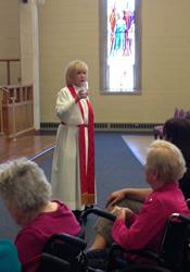 The Rev. Kristen J. Larsen, senior pastor, leads a Worship for the Soul service.