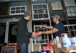 Levi Rogers (right) sells Mason Reedy some of the fairly traded coffee used at Oakhurst United Methodist Church in Decatur, Ga. The church uses as many fairly traded products as possible.