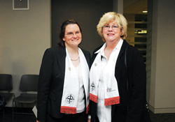 Deaconesses Becky Louter (left) and Nancy Garrison visit at a commissioning service for new deaconesses and home missioners. Louter leads the Office of Deaconess and Home Missioner for United Methodist Women. Garrison serves on a ministry with older adults on Swannanoa, N.C.