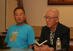 The Rev. Sungho Lee (left) listens to the Rev. Woong-min Kim's meditation during a 2012 workshop in Los Angeles.