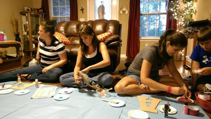 Titus 2 students enjoy a craft party hosted by one of their mentors. Photo courtesy of Cathy Byrd.