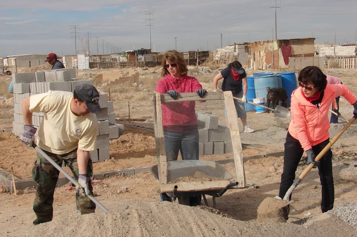 Mission team members from Suncreek United Methodist Church sift out rocks as part of the mortar-making process. They spent three days building a cinder-block home for the Quinoñes family of Ciudad Juárez, Mexico. Photo by Sam Hodges, UMNS.