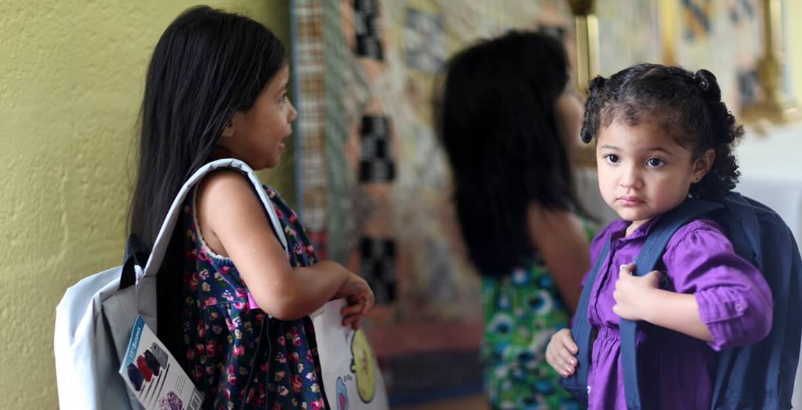 """Children at West Nashville United Methodist Church receive new backpacks for school during a """"blessing of the backpacks."""" 2011 file photo by Kathleen Barry, United Methodist Communications."""