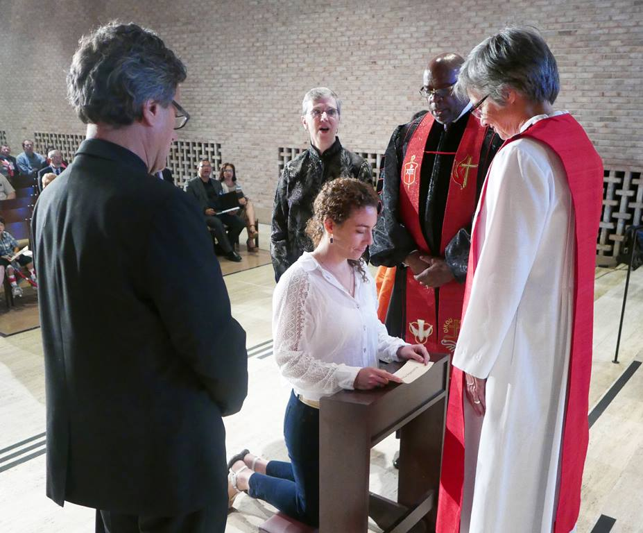 Veronica Apecena kneels during the commissioning of new missionaries Oct. 1 at the Interchurch Center chapel in New York.