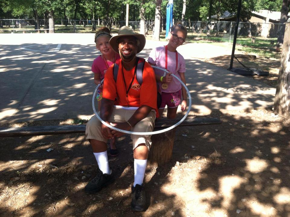 Who's teaching who to hula hoop? Roles sometimes reverse in fun ways at New Day Camp.