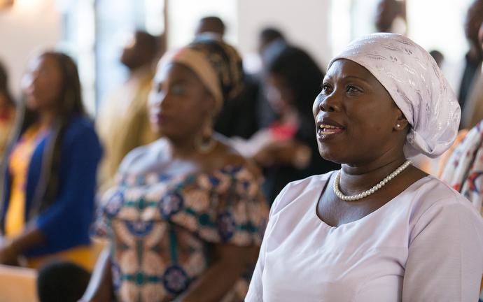Ghanaian migrants sing during worship at Ebenezer United Methodist Church in Hamburg, Germany. Photo by Mike DuBose. UMNS. December 2017.