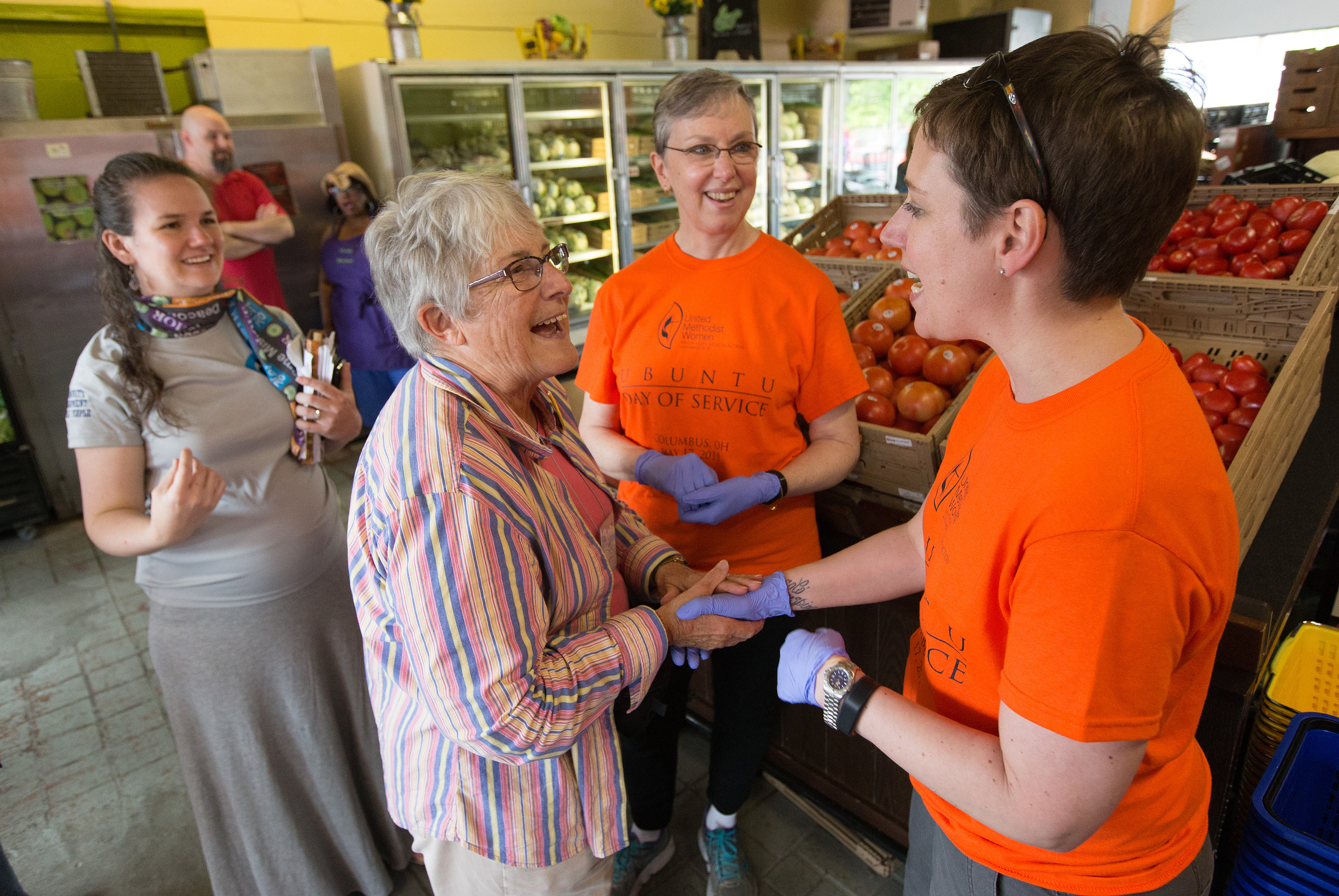 Shannon Priddy (right), the national president of United Methodist Women, and Harriett Jane Olson (center), the organization's chief executive officer, visit with Linda Miller at the All People's Fresh Market in Columbus, Ohio, during the Ubuntu Day of Service, part of the United Methodist Women Assembly 2018 in May. File photo by Mike DuBose, UMNS.