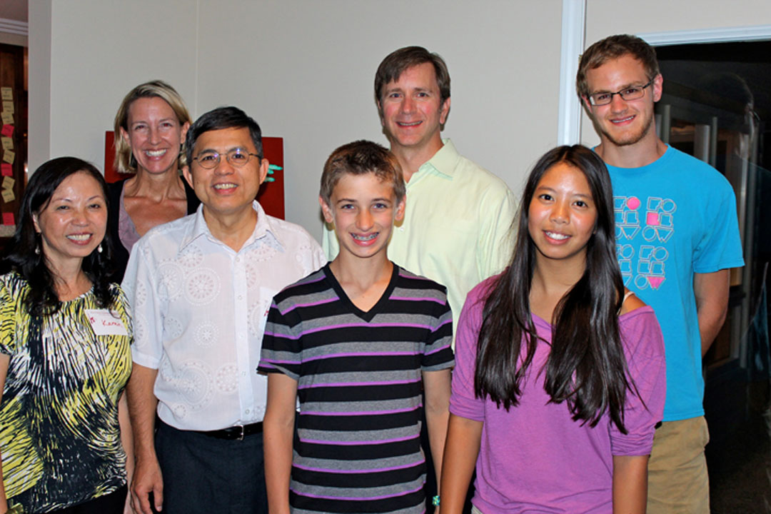 The Work family hosts missionary pastors Ut To and Karen Vo To in Michigan. Pictured: Karen, Julie, Ut, Byron, George, Grace, Charlie. PHOTO: COURTESY JULIE WORK