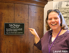 United Methodist History class member Logan Alley with John Wesley's traveling pulpit at the World Methodist Museum at Lake Junaluska. Photo courtesy of Laurel Akin