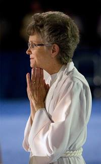 Bishop Peggy Johnson prays during opening worship at the 2012 United Methodist General Conference in Tampa, Florida.