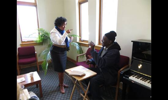 Sarah Whittle (Sign Language interpreter) and Edward Wiggins (Deaf client) at Grace UMC's Deaf Tax Day, Wilmington, Delaware.