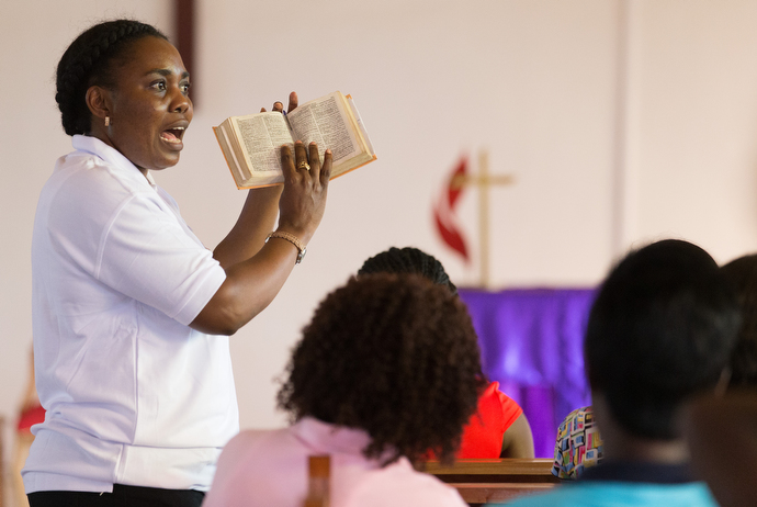 Francine Mpanga Mufuk leads a Bible study on Psalm 91 with young women at Nazareth United Methodist Churchin Abidjan, Côte d'Ivoire. Mpanga Mufuk, a United Methodist missionary from the Democratic Republic of Congo, leads the conference's work with young girls and women in discipleship, counseling, mentoring and relationship building.
