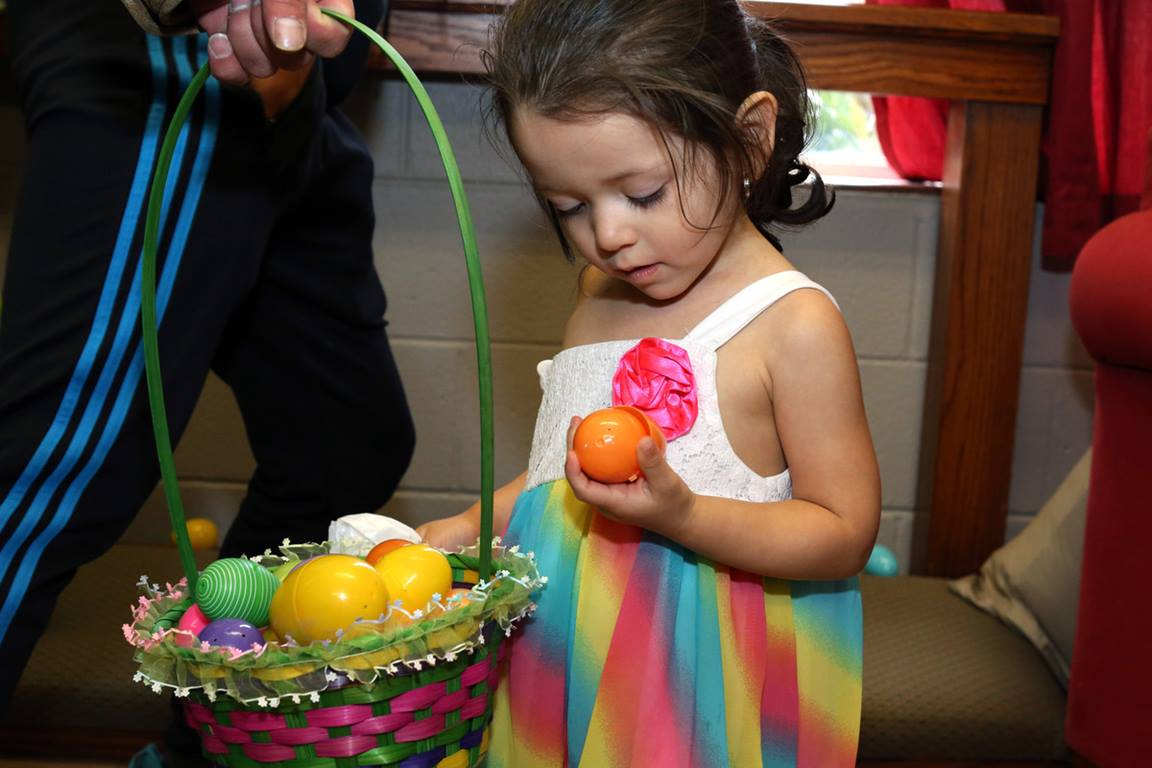 A toddler and her friend enjoy the 2016 Easter Egg Hunt at Hillcrest United Methodist Church in Nashville, Tenn. Activites at home during Holy Week can prepare youngsters as well as adults, to more fully experience the joy of Easter.