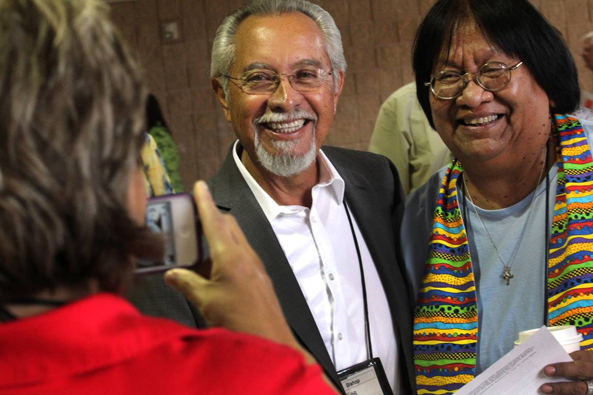 Bishop Elías Galván from Scottsdale, Az. and Tweedy Sombrero from Trinity United Methodist Church in Yuma, Az. are photographed by Anne Marshall from the Connectional Table using a cell phone. Photo by Kathleen Barry, UMNS.