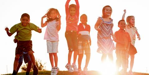 Children playing with sunset in background. Image courtesy of Discipleship Ministries.