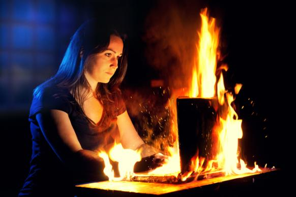 Girl with computer on fire