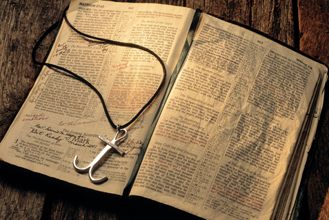A Holy Bible with an anchor cross. Photo illustration by Mike DuBose, UMNS.