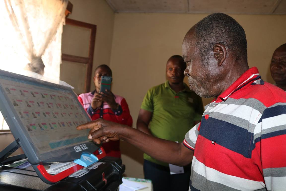 The Rev. Kanda Salumu examines an electronic voting machine during a demonstration in Kindu, Congo. The United Methodist Church is helping educate pastors and laypeople about the machines, which are unfamiliar to many Congolese. Photo by Chadrack Tambwe Londe, UMNS.