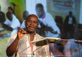 Phileas Jusu of the United Methodist Church in Sierra Leone addresses the 2015 United Methodist Communications Game Changers Summit in Nashville, Tennessee, about the role of technology in fighting Ebola. Photo by Mike DuBose, UMNS.