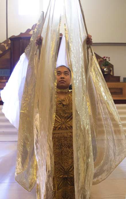 """Ruth Tuifua is part of the Sunday liturgical dance by male and female young adults where they wear """"angel wings."""""""