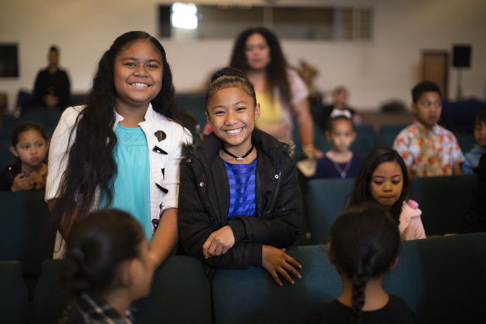 Smiles of welcome are visible everywhere, even for visitors, during the Sunday service at the Tongan United Methodist Church.