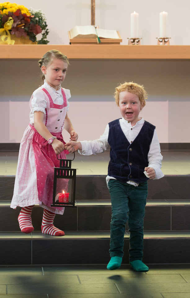 Selma (left) and Arthur Härtel carry the lantern to lead the way for children's church at the United Methodist Church of the Redeemer in Munich, Germany. Photo by Mike DuBose, UMNS.