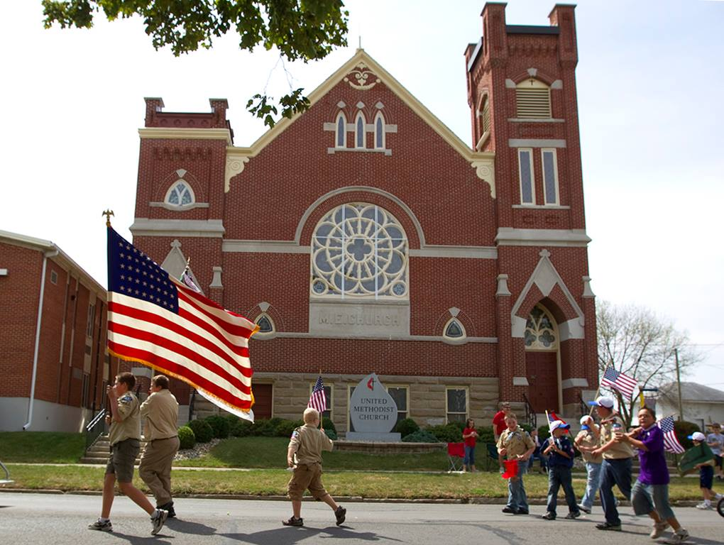Boy Scouts from Troop 222 march in front of Leipsic (Ohio) United Methodist Church during the parade that kicks off the town's annual Fall Festival. Watching the parade, at left, is Luke Lammers. Photo by Mike DuBose, UMNS.