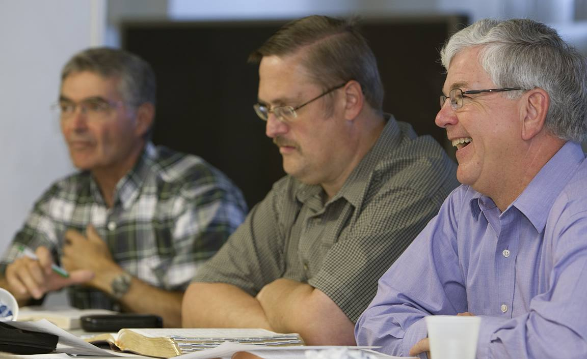 The Rev. Bill Patterson (right) helps lead a men's Bible study at Leipsic (Ohio) United Methodist Church. At left are Ken Rider and Craig Wykoff. Photo by Mike DuBose, UMNS.