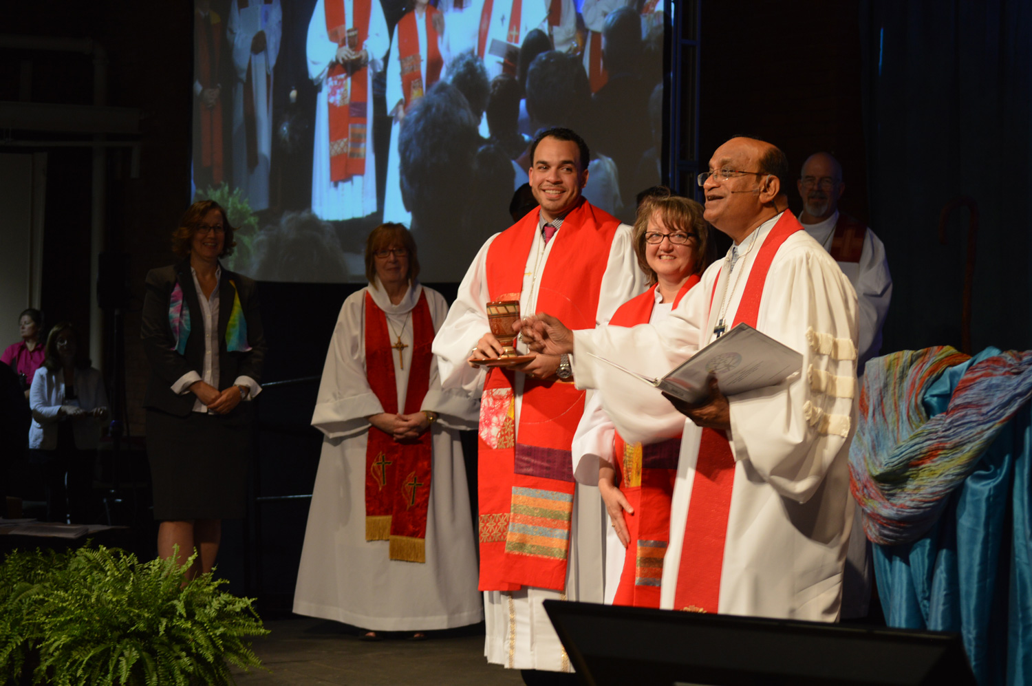 One of the first things many new clergy do after their ordination is help serve communion during the ordination worship service. Photo by Beth DiCocco, New England Conference.