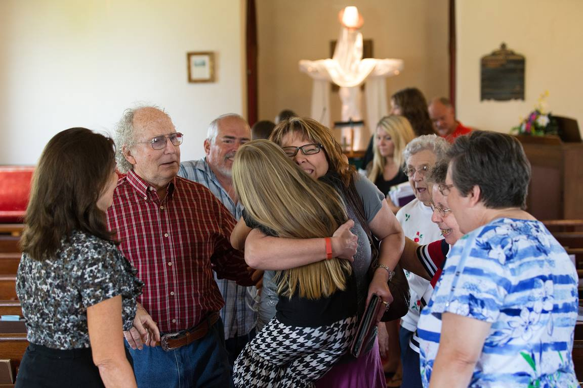 Pastor Laura Vincent hugs Hailey Embrey, 8, following worship at Shiloh United Methodist Church near Clinton, Ky. Photo by Mike DuBose, UMNS.