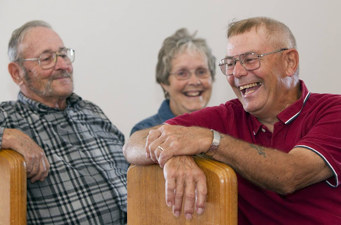 Ben Smith (right) shares a laugh with Roy and Nancy Goodwin at New Hope Bethel United Methodist Church outside Leipsic, Ohio. Photo by Mike DuBose, UMNS.