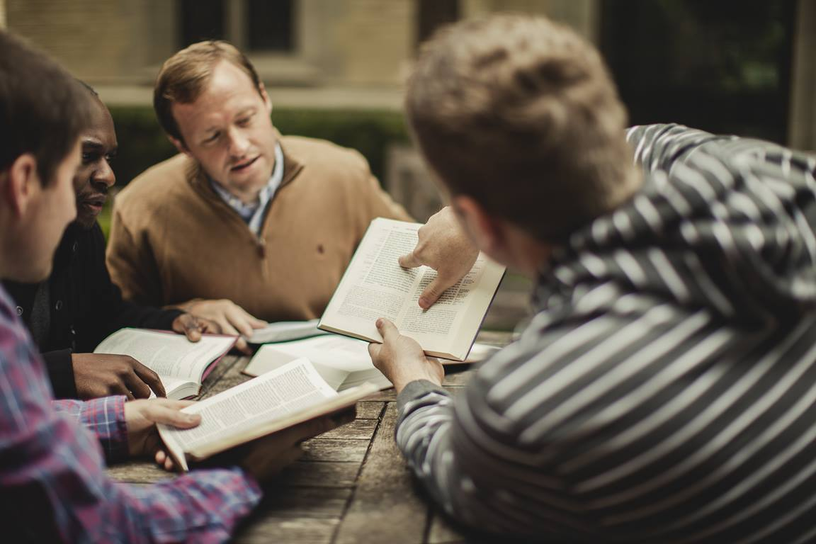 A small group of men study the Bible. Photo by Shaun Menary, Lightstock.com.