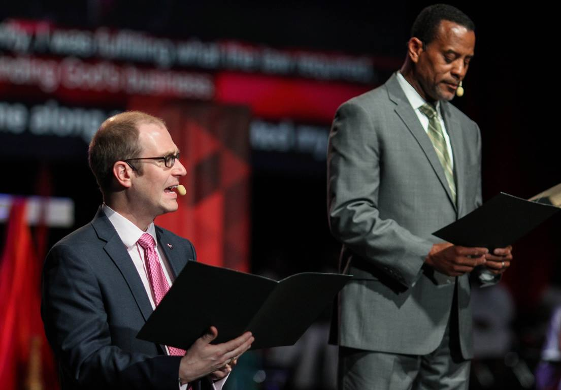 Morning Worship – May 13: An unidentified man (left), a delegate from Central Texas Conference, and Byron Thomas, delegate from North Georgia, participate in the May 13 morning worship of the United Methodist 2016 General Conference in Portland, Ore. Photo by Maile Bradifeld, UMNS.
