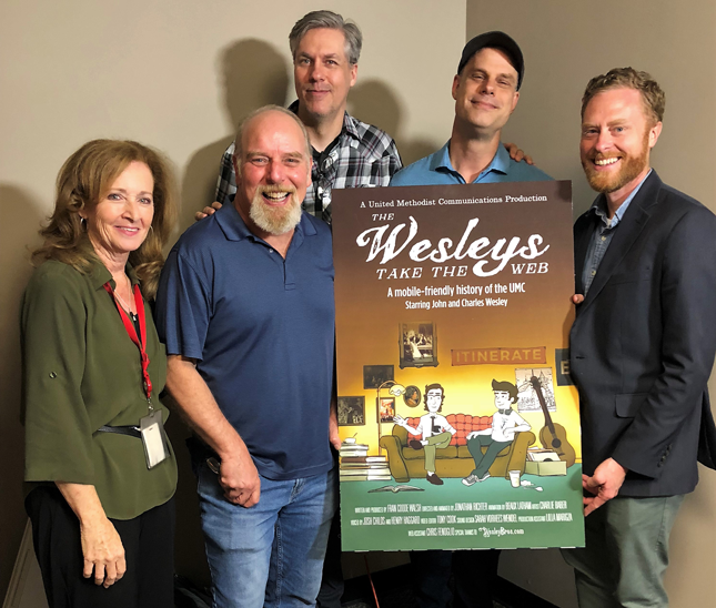 """The team that created """"The Wesleys Take the Web"""" gathered at United Methodist Communications in June 2018.Front row (left to right): Fran Coode Walsh, script writer and producer; Henry Haggard, voice of John Wesley;the Rev. Charlie Baber, creator of the WesleyBros.com characters. Backrow (left to right):Josh Childs, voice of Charles Wesley; Jonathan Richter, animator."""