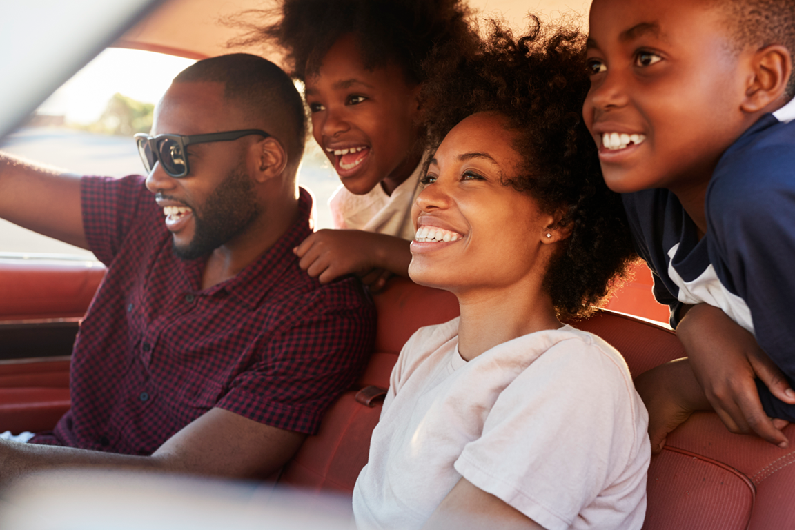 Family enjoying a road trip during summer vacation. Image by MonkeyBusinessImages, iStockphoto.com.