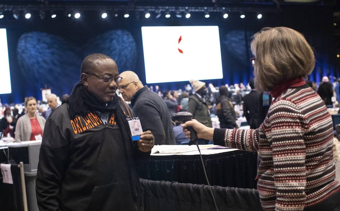 Marlene Fenstermacher, serving as a marshal at the 2019 special session of The United Methodist General Conference, scans in delegate Vargas Umba from North Katanga to the plenary floor. Photo by Kathleen Barry, UM News.