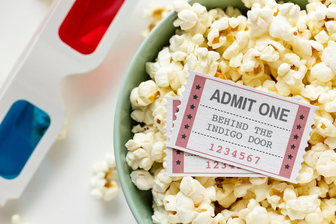 Movie ticket in a bowl of popcorn. Photo courtesy of rawpixel.com from Pexels.