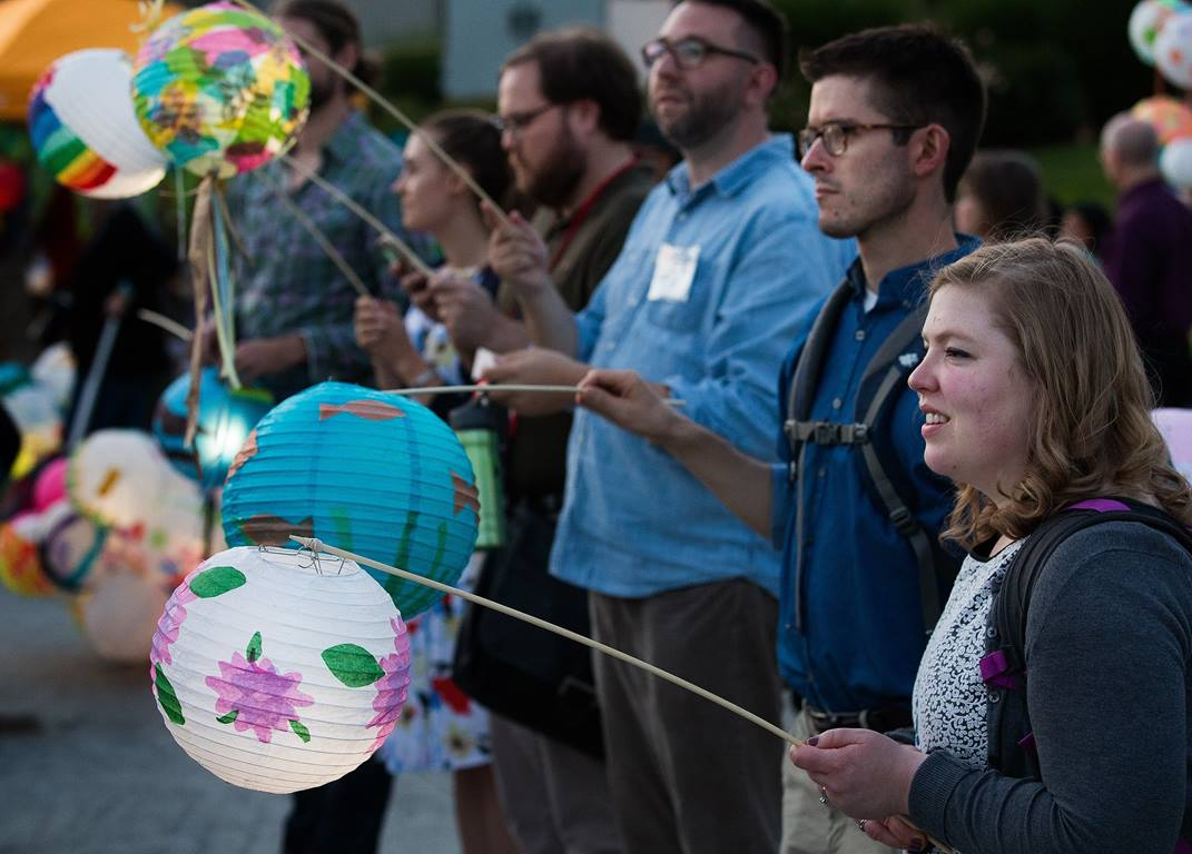 Katie Crise (right) holds a lantern lit by a solar powered lamp during the General Conference Climate Vigil at Oregon Convention Center Plaza in Portland. The vigil was held to call attention to climate change during the meeting of The United Methodist Church's top legislative body. Photo by Mike DuBose, UMNS.