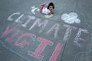 Delilah Rose Jackson, age 1 1/2, crawls on a chalk drawing at the May 12th General Conference Climate Vigil at the Oregon Convention Center Plaza in Portland. Photo by Kathleen Barry, UMNS.