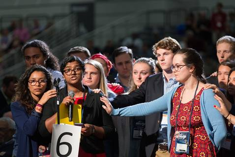 Ann Jacob of the Eastern Pennsylvania Conference is surrounded by other young people as she reads a statement on church unity adopted by the Global Young People's Convocation and Legislative Assembly. She presented the statement adopted in July 2015 during the afternoon plenary May 18 at the 2016 United Methodist General Conference in Portland, Ore. Photo by Mike DuBose, UMNS.