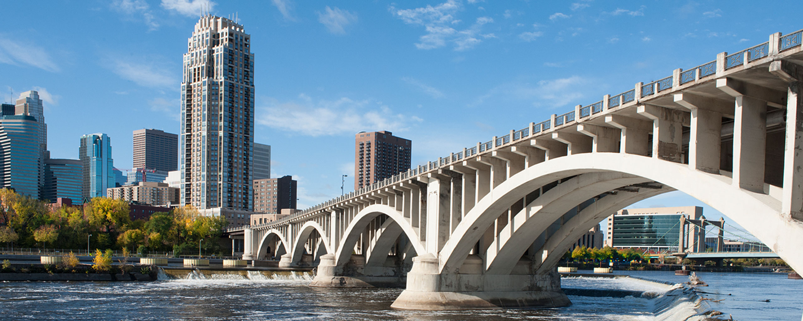 Minneapolis Skyline and 3rd Avenue Bridge. Photo by Krivit Photography, courtesy of Meet Minneapolis.