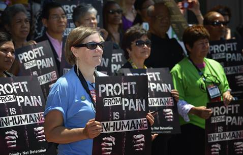 People from from around the world participate in a rally against private prisons during the 2012 United Methodist General Conference in Tampa, Fla. The rally was sponsored by United Methodist Women and the United Methodist Task Force on Immigration. A UMNS photo by Paul Jeffrey.