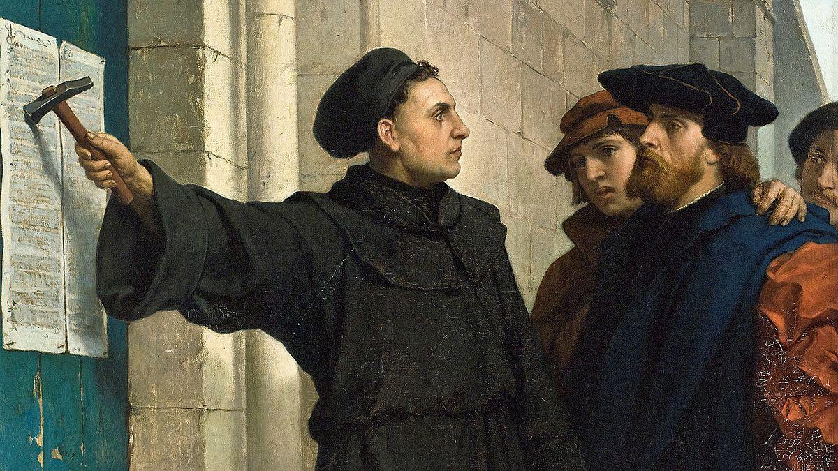 La pintura por Ferdinand Pauwels de Martin Luthero publicando sus 95 tesis en 1517, Wiki Commons.