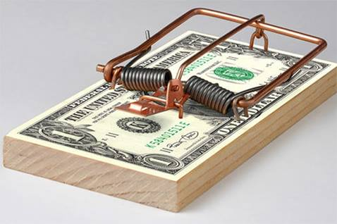 Courtesy/Stock photo. Image of dollar bills in a mousetrap.