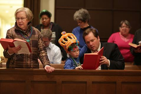 Congregants of West End United Methodist church join in singing from the hymnal during the Shrove Tuesday celebration held March 2, 2014 at West End United Methodist Church. Photo by Kathleen Barry, UMNS.