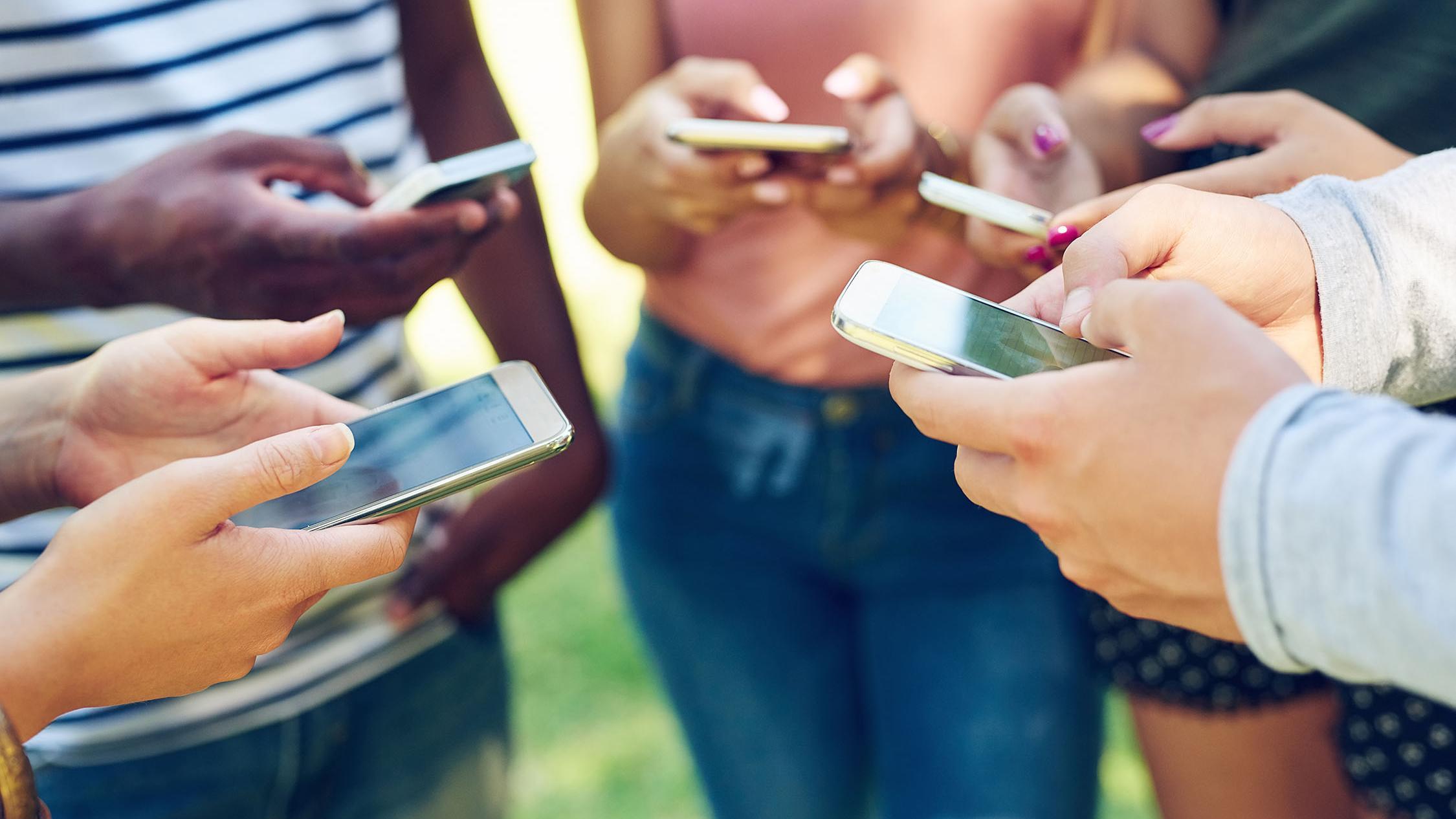 Group using smart phones. Courtesy of GCFA. 2020